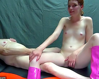 Skinny legal age teenager in knee high boots is having pleasure with her old lesbo ally