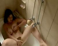 Busty dark brown European girlfriend masturbates in the bathtub
