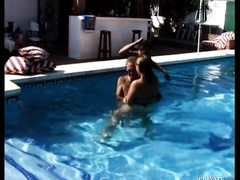 That milf in the pool would like to fuck a pair of studs