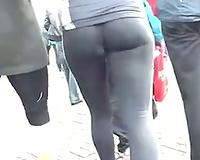 Following hawt playgirl with admirable gazoo cheeks wearing tight leggings