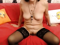 Mature floozy in nylon nylons masturbating passionately with sex toy