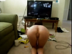My youthful small GF plays Xbox all bare in doggy pose