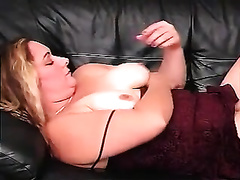 Chubby and breasty golden-haired playgirl on the bed pleasing herself