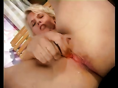 Wild golden-haired cougar voraciously pokes herself with a dildo