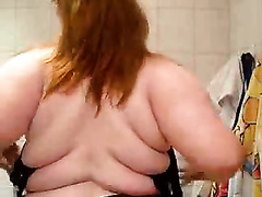 Fat redhead aged housewife is proud of her large boobies
