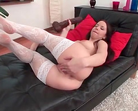 Filthy perverted dark brown girlie in white lacy nylons just likes masturbating