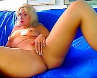 Voluptuous blond sexpot rubs her taut bald cunny