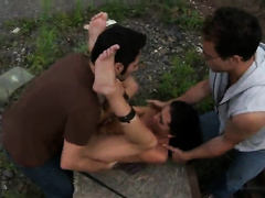 Two nasty studs rape a young nude girl on the ground in the woods