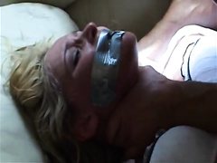 Gagged blonde in black nylon stockings experiences anal rape