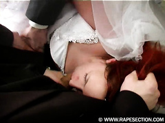 Horny redhead raped in a bedroom by her two insatiable co-workers