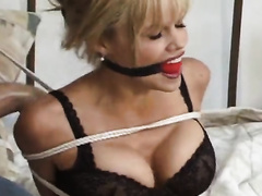 Gorgeous blonde wife with big breasts in the hands of two rapists