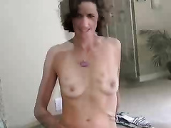 Sexy brunette wife strip dances to the music for husband friends