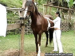 Exotic slutty wife sneaks off her horse and engages in zoo sex