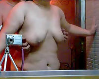Lewd chubby Japanese pair has some kind of perverted workout in front of mirror