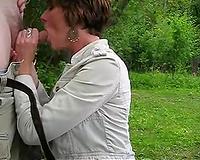 Housewife sucks cock outdoors