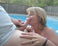 Exhibitionist wife sucks hubby off by the pool