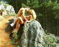 Busty golden-haired haired sweetie acquires screwed in woods hard