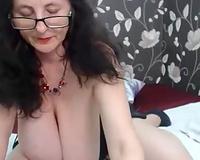Nasty mature floozy with giant natural milk sacks masturbates passionately
