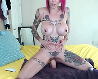 Pink haired used looking tattooed slut uses dildo to please herself