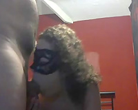 Curly-haired masked hooker pleases me with a deepthroat fellatio