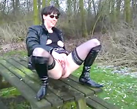 Outdoor Fun on a park bench with a big black dildo while being filmed by husband