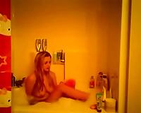 Auburn nympho was kinda having enjoyment all in nature's garb in the bath
