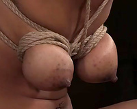 Hot brown skin chick got her boobs bound up in BDSM