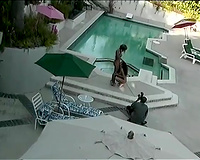Large dark rod for 2 perverted and lascivious honeys in the swimming pool
