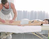 Tattooed brunette diva receives fingered during the massage session
