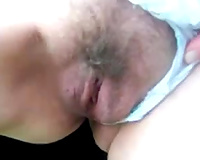 Finger fucking my lascivious wife's unshaved cookie in public park