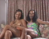 Two chocolate swarthy divas give an inerview and strip
