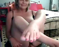 Mature seductress in sexy silk lingerie posing on livecam