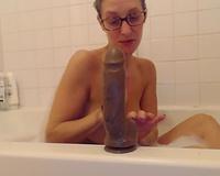 Wife fucking Herself In Bathtub With Big Black Dildo