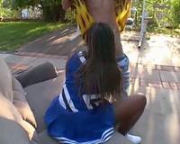 White chap eats out a dark cheerleader