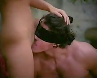 Blindfolded fellows are blown in group sex outdoors