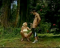 Black man takes a blond backdoor outdoors