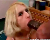 Cute golden-haired sucks on a massive dark jock