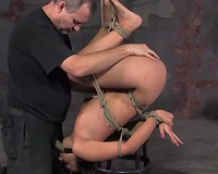 BDSM act with brunette hair chick Crissy getting face-fucked