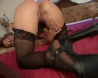 Sexy mama in glasses sucks a dark wood and enjoys it hard doggy style