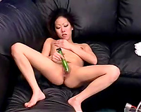 Svelte Asian playgirl is all naked masturbates with green vibrator
