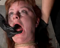 Ugly gingerhead housewife tied on the wooden chair and spanked