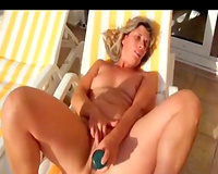 Wife sex in vacation she sunbathing playing with toy and sucking big cock