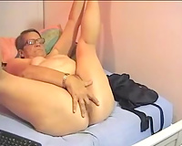 Mature short haired black cock slut on livecam strips and masturbates