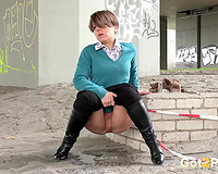 Short haired nerdy amateur wife from the library voids urine in public place