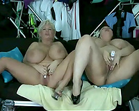 Extremely kinky nymphos with massive boobies masturbate on cam