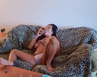 Busty black skin charming girlfriend on the daybed masturbating
