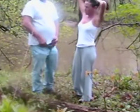 Trashy brunette hair hoe gives head and bonks doggy style outdoor