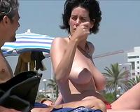 Spying on glamorous woman on a nudist beach