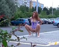 Sweet redhead hottie on the parking lot pissing in daytime