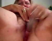 Mature blond wench masturbating with a pair of dildos